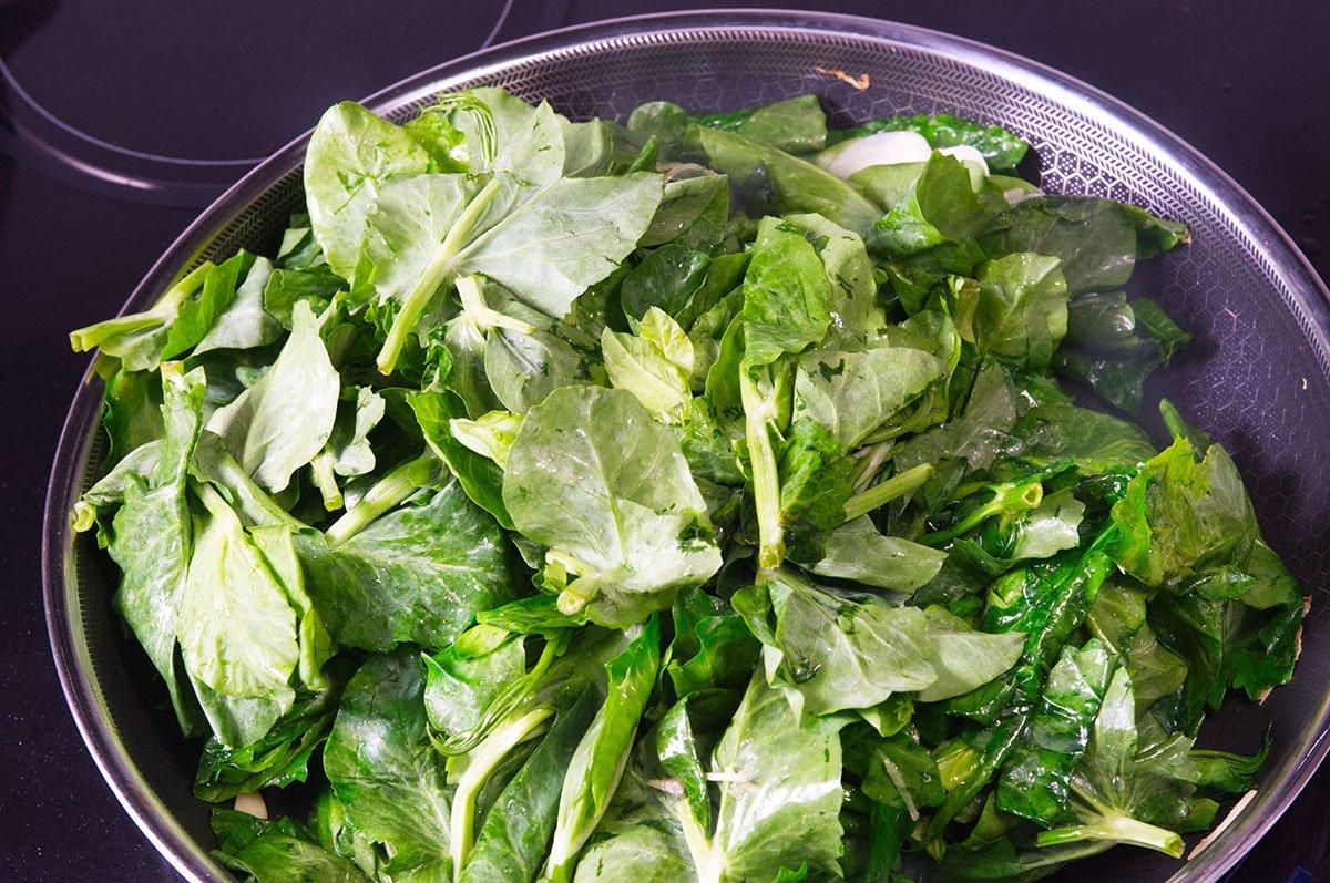 green stir fried pea shoots